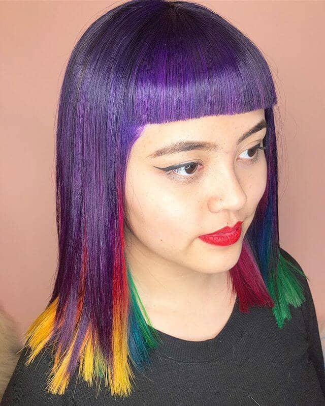 Mod Cut Purple Bangs and Chunky Rainbow Layers