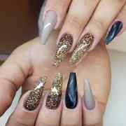 beautiful black and gold nail