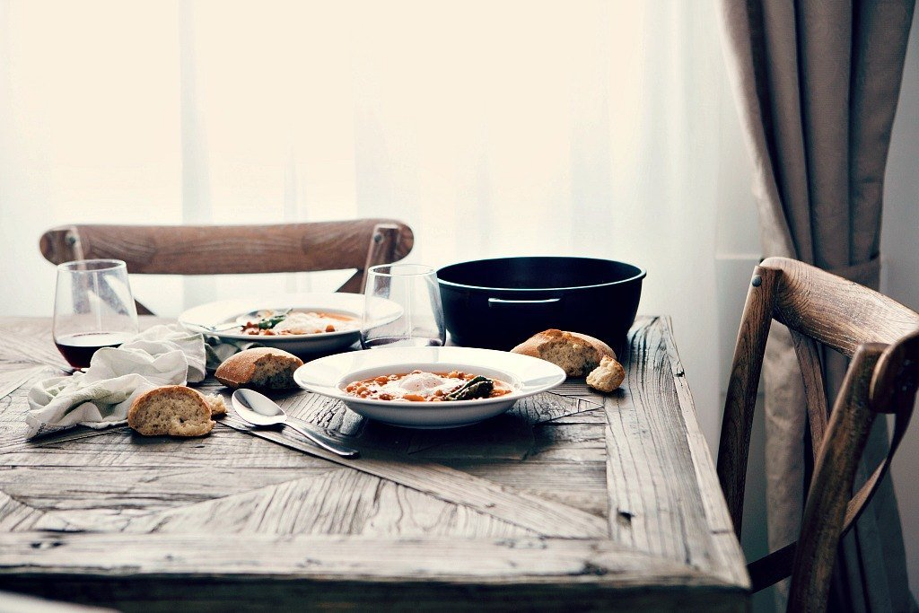 soup and bread on a wooden table