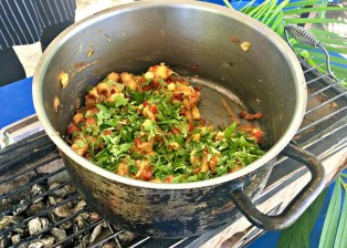 pot of breadfruit hash with parsley on a grill