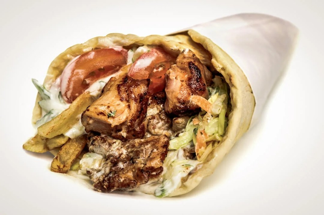 greek gyros stuffed with meat, salad, onion, tomato and potato