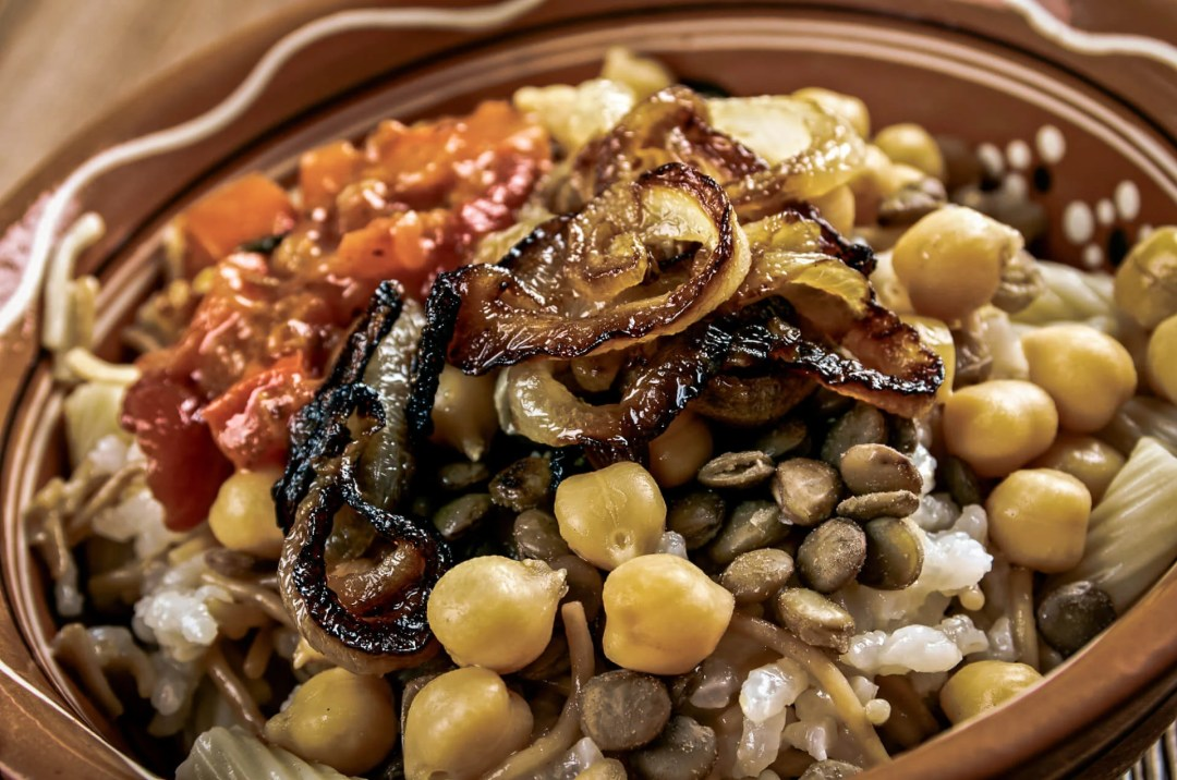 Popular Middle Eastern foods: Kushari - an Egyptian dish of rice, macaroni and lentils mixed together, topped with a tomato-vinegar sauce; some add short pieces of spaghetti garnished with chickpeas and crispy fried onions