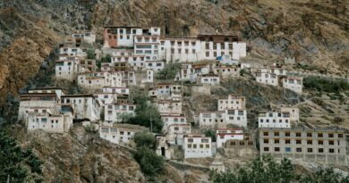 ancient tibetan monastery located on mountain slope in wild valley