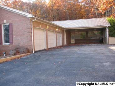 3 Car Garage with 2 Car Carport on right side! That's excluding all the parking in front, on the left side!