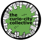 A circular logo with buildings, birds and the text inside in black with green background reads the curio-city collective.