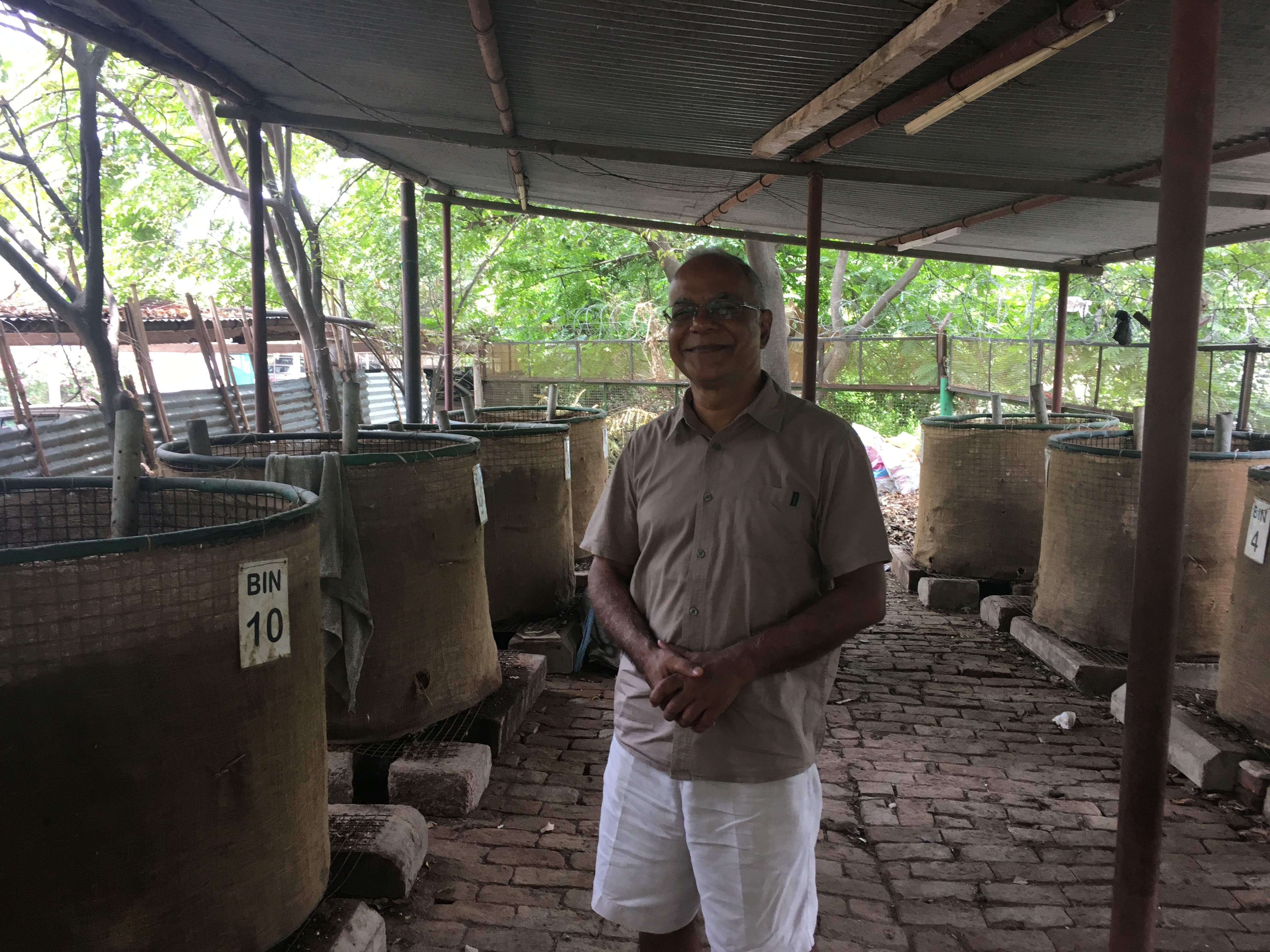 Keshav uncle standing in the composting area