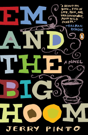 The cover page of the book Em and the Big Hoom which has the name written out in capitals against a black background with a something cooking and swirls all around. Jerry Pinto is underneath.