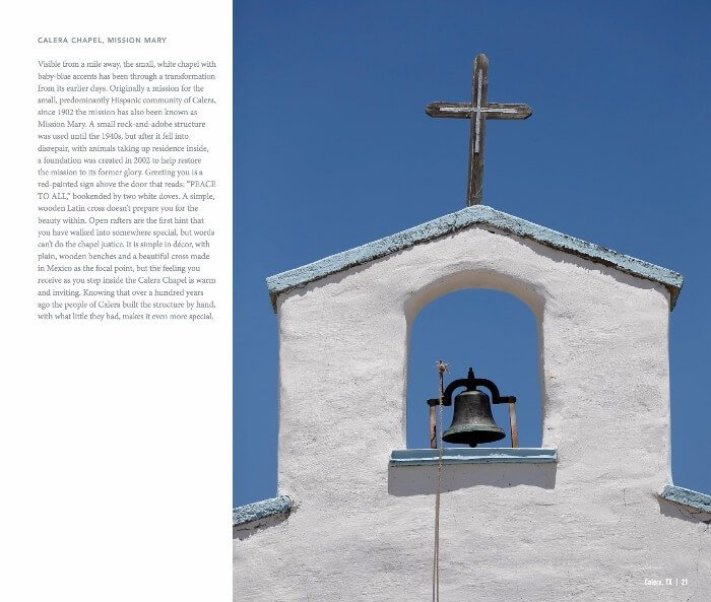 white adobe church tower with a bell and a cross against a bright blue sky