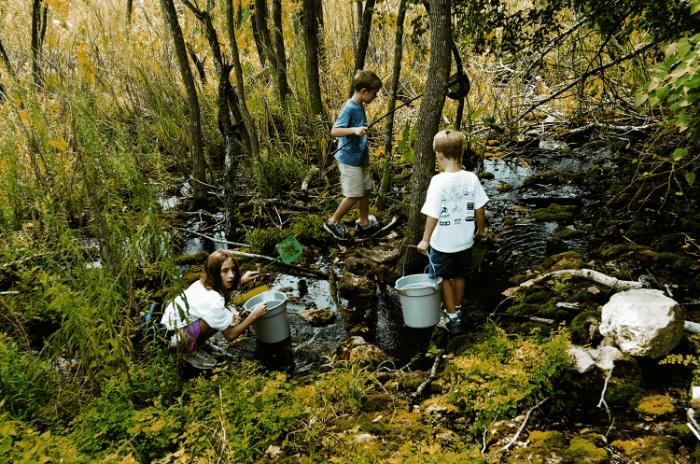 Quirky Texas Kids exploring a stream