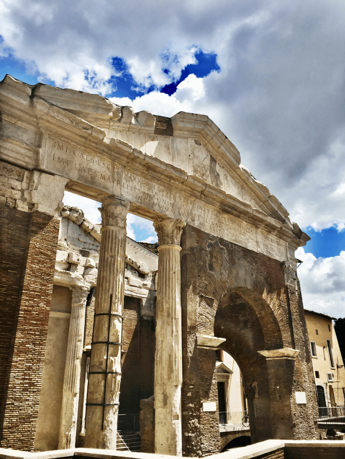 Roman ruins underneath a blue sky with clouds
