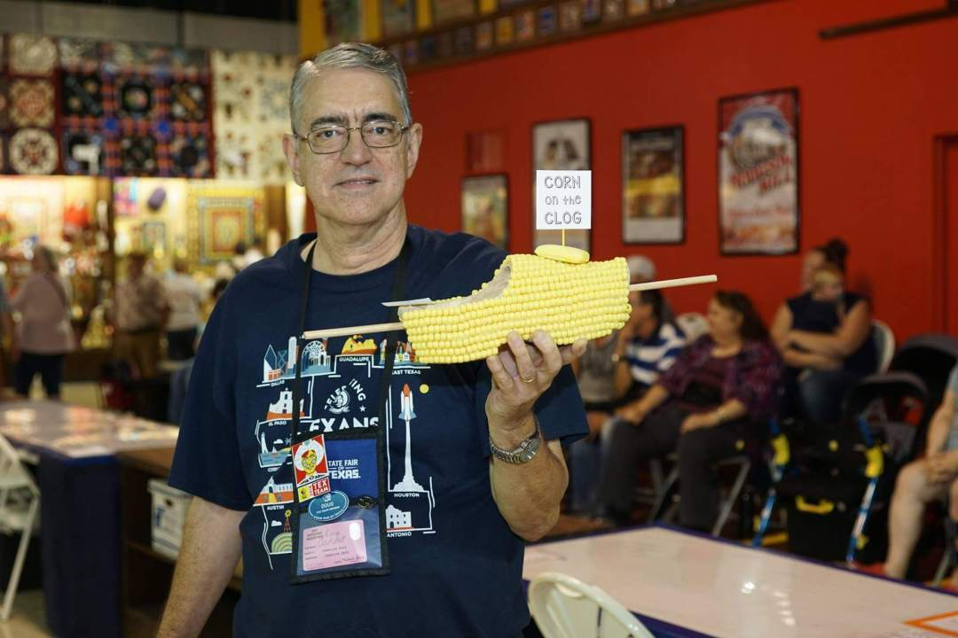 Ribbon Winners Judge with Corn on the Clog