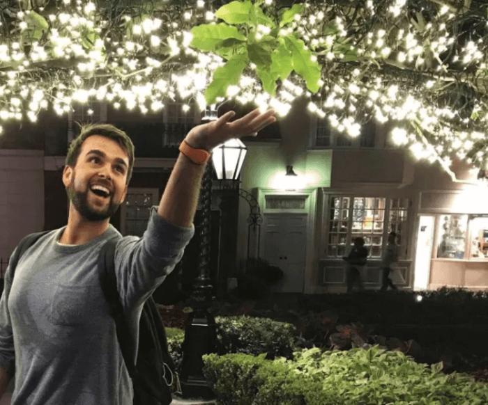 Adam Hattan under twinkle lights
