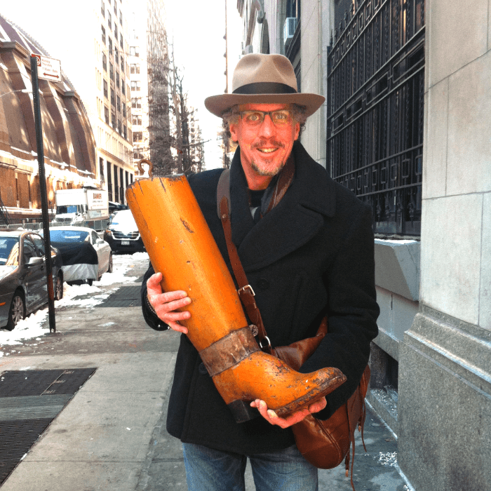 Will Evans holding a Folk Art Trade Sign in NYC