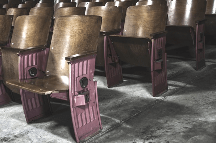 rows of wooden theater seats