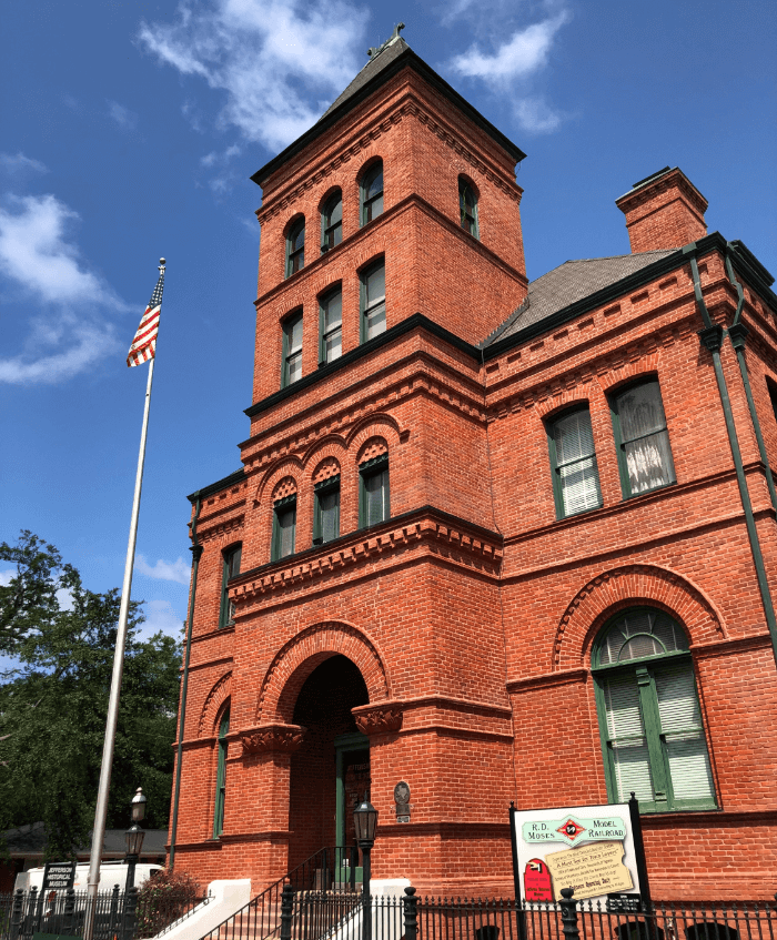 Historic Red Brick Courthouse under a bright blue sky