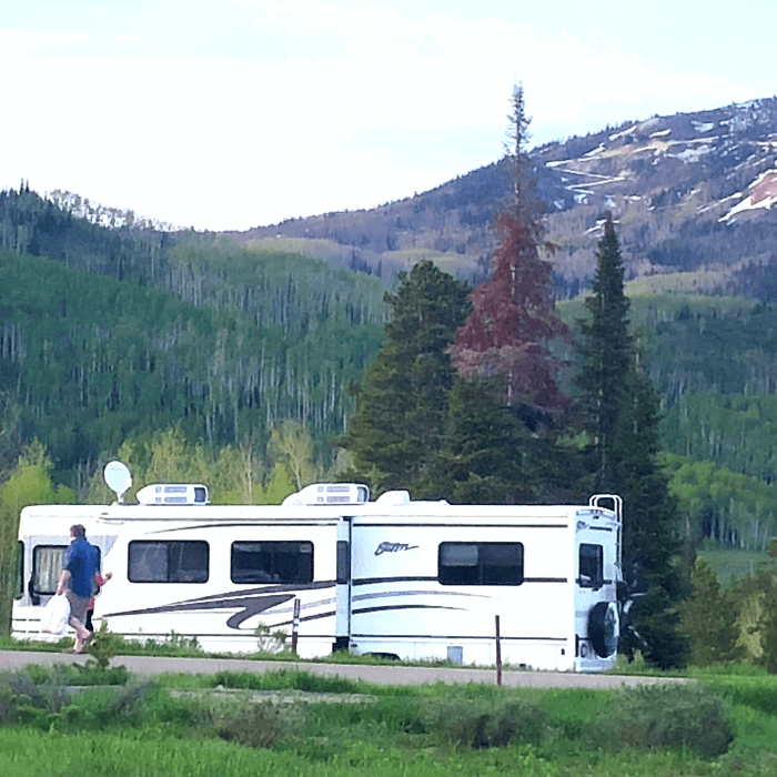 White RV with mountains in the background