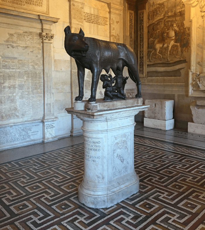 Bronze Wolf on a white marble stand