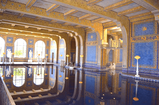 indoor swimming pool with ornate blue and gold ceilings and walls