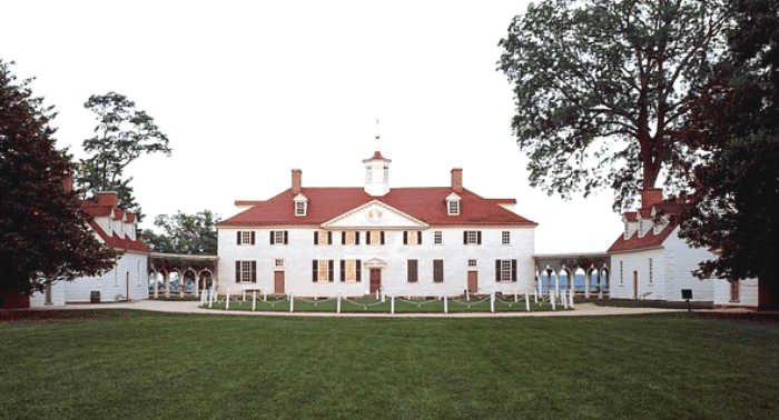 A White Mansion, known as Mount Vernon, with a red tile roof and a large green lawn in front