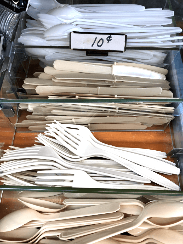 a display of plastic forks and knives and spoons