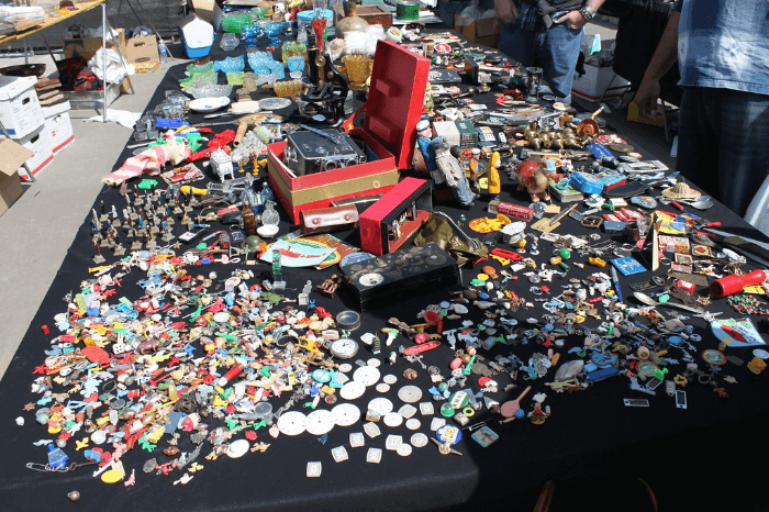 a table filled with buttons and small objects at the Rose Bowl Flea Market
