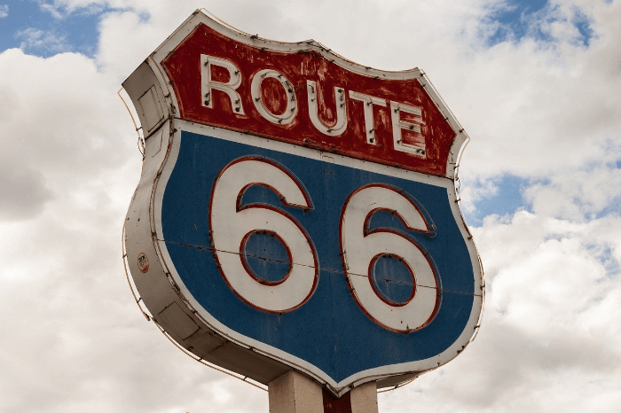 vintage blue and red Route 66 Highway sign