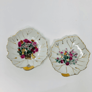 two leaf shaped plates with floral decoration