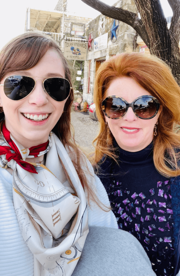 two women in sunglasses smiling at the camera