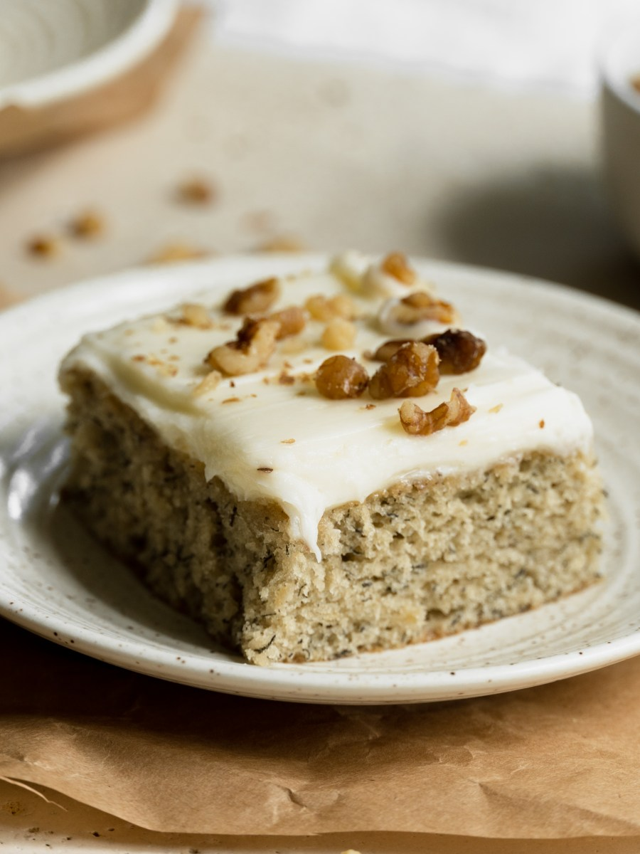 Banana cake with cream cheese frosting on plate