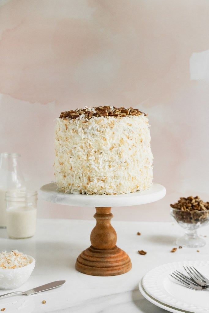 coconut carrot cake on cake stand