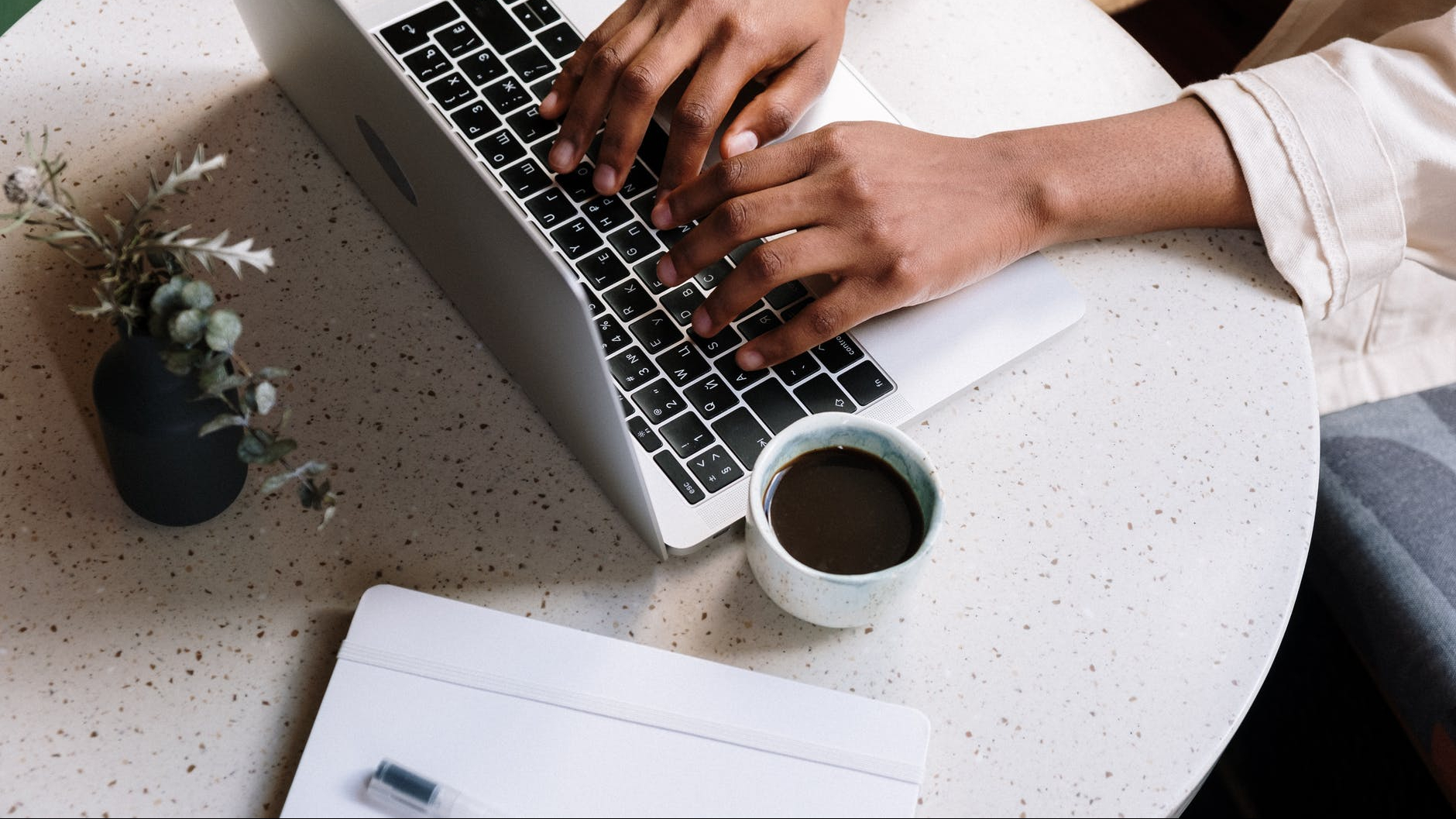 Person working from home with coffee cup