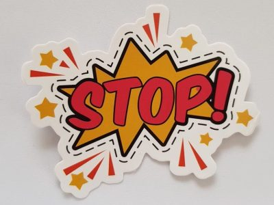 red and yellow stop sticker