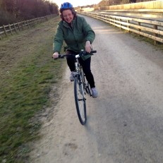 Rachel cycling on the Busway