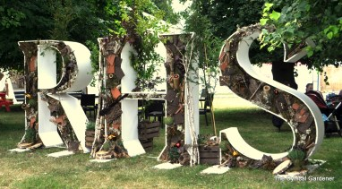 The RHS Sign. (Saw this at Chatsworth Flower Show).
