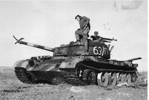 Israeli soldier examines a destroyed T-62
