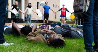 """UH students laid on the grass for the """"UH Die-In for Eric Garner."""" 