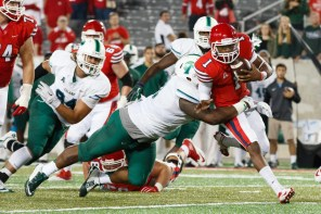 Tulane defenders were able to keep UH's Greg Ward in check, sacking the sophomore quarterback three times and intercepting three of his passes, including the game-clincher from cornerback Parry Nickerson. | Justin Tijerina/ The Cougar