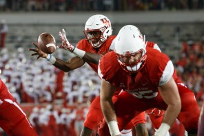 Junior quarterback Greg Ward, Jr., center, had a career night en route to the UH victory, as he complied six total touchdowns on the night. | Justin Tijerina/The Cougar