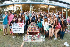 Tau Kappa Epsilon and Chi Omega showed their homecoming spirit by constructing a massive football helmet from cans. | Photo by Justin Cross.