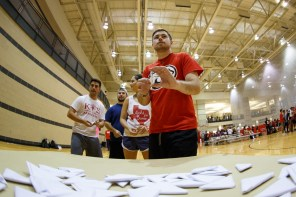 Sports administration senior Taylor Rouleau attempts to score paper footballs at the Coog-lympics. | Photo by Justin Tijiera/The Cougar.