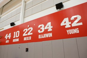 The names and numbers of retired legends hang above the men's court. | Justin Tijerina/The Cougar