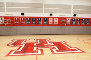 Banners featuring tournament appearances hang along the side of the courts. | Justin Tijerina/The Cougar