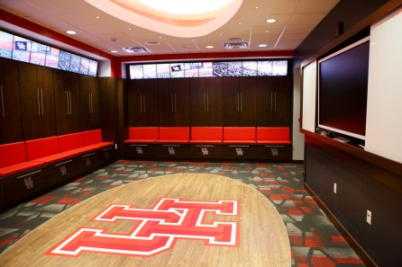 The locker rooms are ringed by screens above each locker, which can scroll stats and notes from the season. | Justin Tijerina/The Cougar