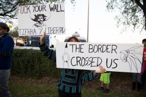 Protesters bashed Trump for his policies regarding building a wall between the U.S. - Mexico border. | Photo by Justin Cross.