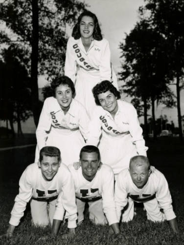 Judy Morris (top) and Jan McMullen (center left) and four other unidentified cheerleaders made cheerleader triangle. | Courtesy of UH