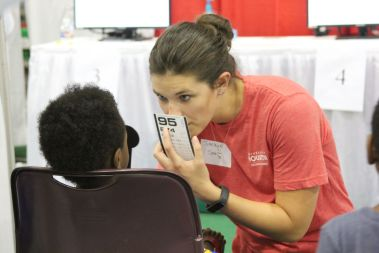 Since many elementary students can and do fall through the cracks when it comes to vision testing, free tests at the Back 2 School Fest proved vital.   Emily Burleson/The Cougar