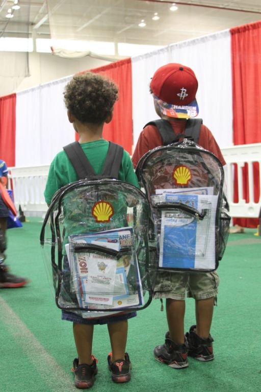 After winding through pop-up doctors' appointments and attractions like Cougar football photo ops, students finally received the promised school supplies. | Emily Burleson/The Cougar