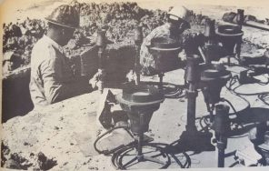 """""""If you think these workmen are looking for a dime lost when the Quadrangle Fountain was laid, you're wrong."""" Liborio Amador and Sergie Arrila were seeking a leaky water pipe Monday, which developed under the fountain.   Taken from The Cougar, 1972"""