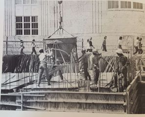 Construction started in November 1971, but was delayed during the summer of 1972. In this photo, workers laid down the pipes for the fountain while students head to class.   Taken from The Cougar, 1972