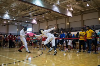 Accounting junior Joe Blount spars with an opponent at Cat's Back. Fencing is one of dozens of official Sports Clubs students can join. | Justin Cross/The Cougar